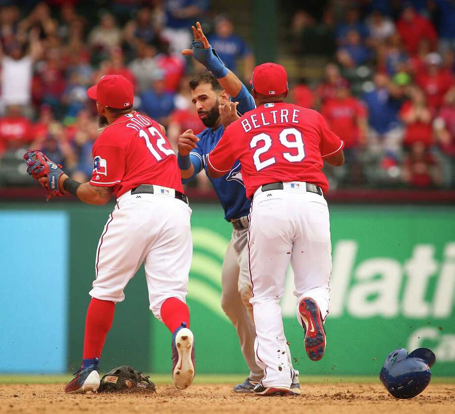 Rougned Odor's punch to the face of Toronto's Jose Bautista on Sunday was cheered by many. Texas Rangers second baseman Rougned Odor (12) and Toronto Blue Jays Jose Bautista (19) fight as third baseman Adrian Beltre (29) moves to break it up in the 8th inning at Globe Life Park on May 15, 2016 in Arlington, Texas. The Rangers won 7-6. (Richard W. Rodriguez/Fort Worth Star-Telegram/TNS) Photo: Richard W. Rodriguez / Fort Worth Star-Telegram / Fort Worth Star-Telegram