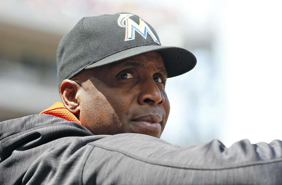 Miami Marlins hitting coach Barry Bonds stands in the dugout during a baseball game against the Washington Nationals at Nationals Park, Sunday, May 15, 2016, in Washington. (AP Photo/Alex Brandon)