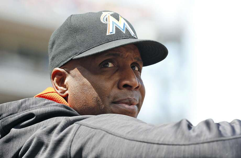 Miami Marlins hitting coach Barry Bonds stands in the dugout during a baseball game against the Washington Nationals at Nationals Park, Sunday, May 15, 2016, in Washington. (AP Photo/Alex Brandon) Photo: Alex Brandon, Associated Press