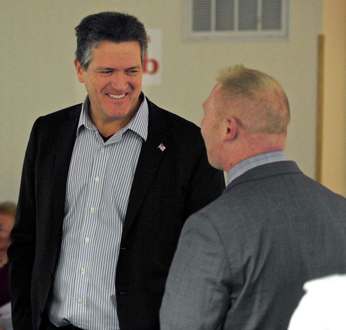 August Wolf, of Stamford, talks with State Representative Stephen Harding, of Brookfield, at the Connecticut Republican Party Presidential Straw Poll held in Brookfield, Conn, on Friday night, January 15, 2016. Wolf is running for the U.S. Senate.