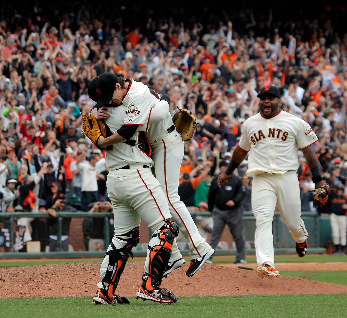 Pitcher Tim Lincecum, center, is mobbed by catcher Hector Sanchez, left, and third baseman Pablo Sandoval after he pitched a no hitter as the San Francisco Giants played the San Diego Padres at AT&T Park in San Francisco, Calif., on Wednesday, June 25, 2014, defeating the Padres 4-0.