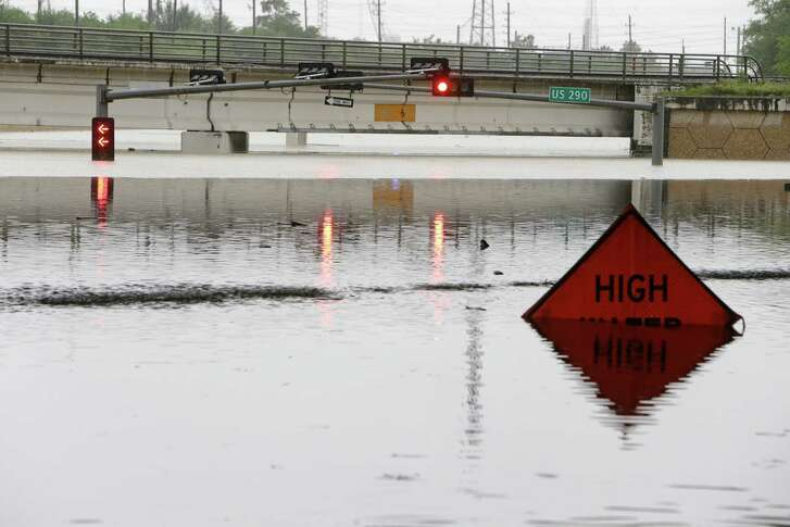 The sign tells the story of the flooded roadway of the FM 529 underpass at U.S. 290 near Jersey Village. (Melissa Phillip / Houston Chronicle )
