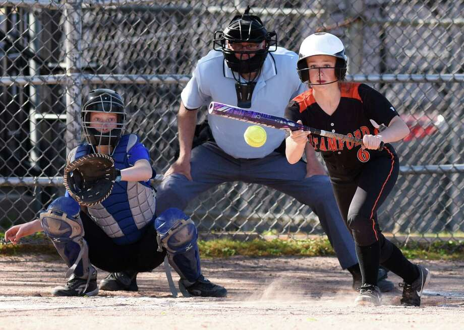 Stamford's Gloria Mattioli (6) lays down a bunt beside Ludlowe catcher Lillian Traum in Stamford's 7-6 win over Fairfield Ludlowe in the high school softball game at Stamford High School in Stamford, Conn. Monday, May 16, 2016. Photo: Tyler Sizemore / Hearst Connecticut Media / Greenwich Time