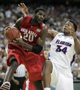 Ohio State center Greg Oden (20) looks to pass against Florida's Marreese Speights (34) in the second half during their men's championship basketball game at the Final Four in the Georgia Dome in Atlanta Monday, April 2, 2007. (AP Photo/Mark Humphrey)