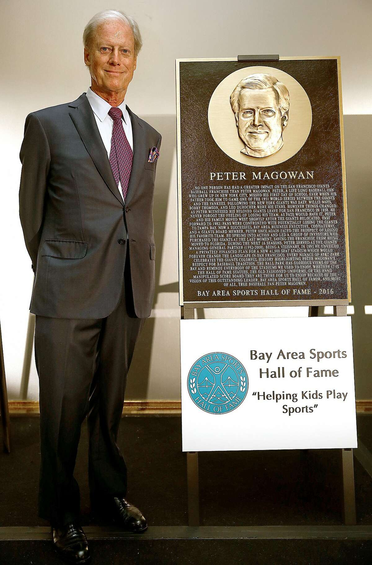 Former Giants owner Peter Magowan stands next to his bronze plaque at the St. Francis Hotel in San Francisco, California, on monday, may 16, 2016.