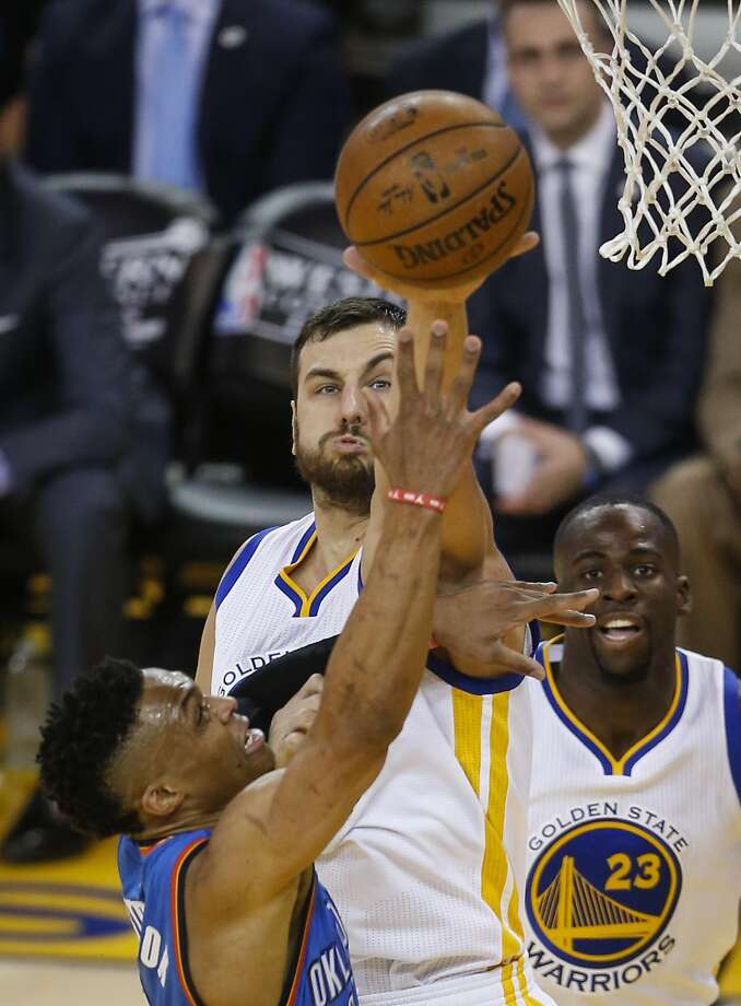 Golden State Warriors Andrew Bogut blocks a shot by Oklahoma City Thunders Russell Westbrook in the first quarter during Game 1 of the NBA Western Conference Finals at Oracle Arena on Monday, May 16, 2016 in Oakland, Calif. Photo: Scott Strazzante, The Chronicle
