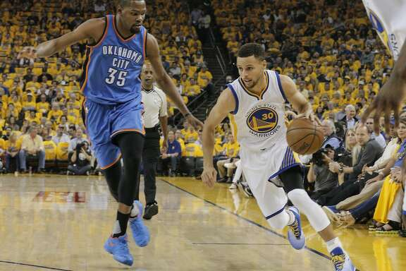 Golden State Warriors� Stephen Curry gets past Oklahoma City Thunders� Kevin Durant in the first quarter during Game 1 of the NBA Western Conference Finals at Oracle Arena on Monday, May 16, 2016 in Oakland, Calif.