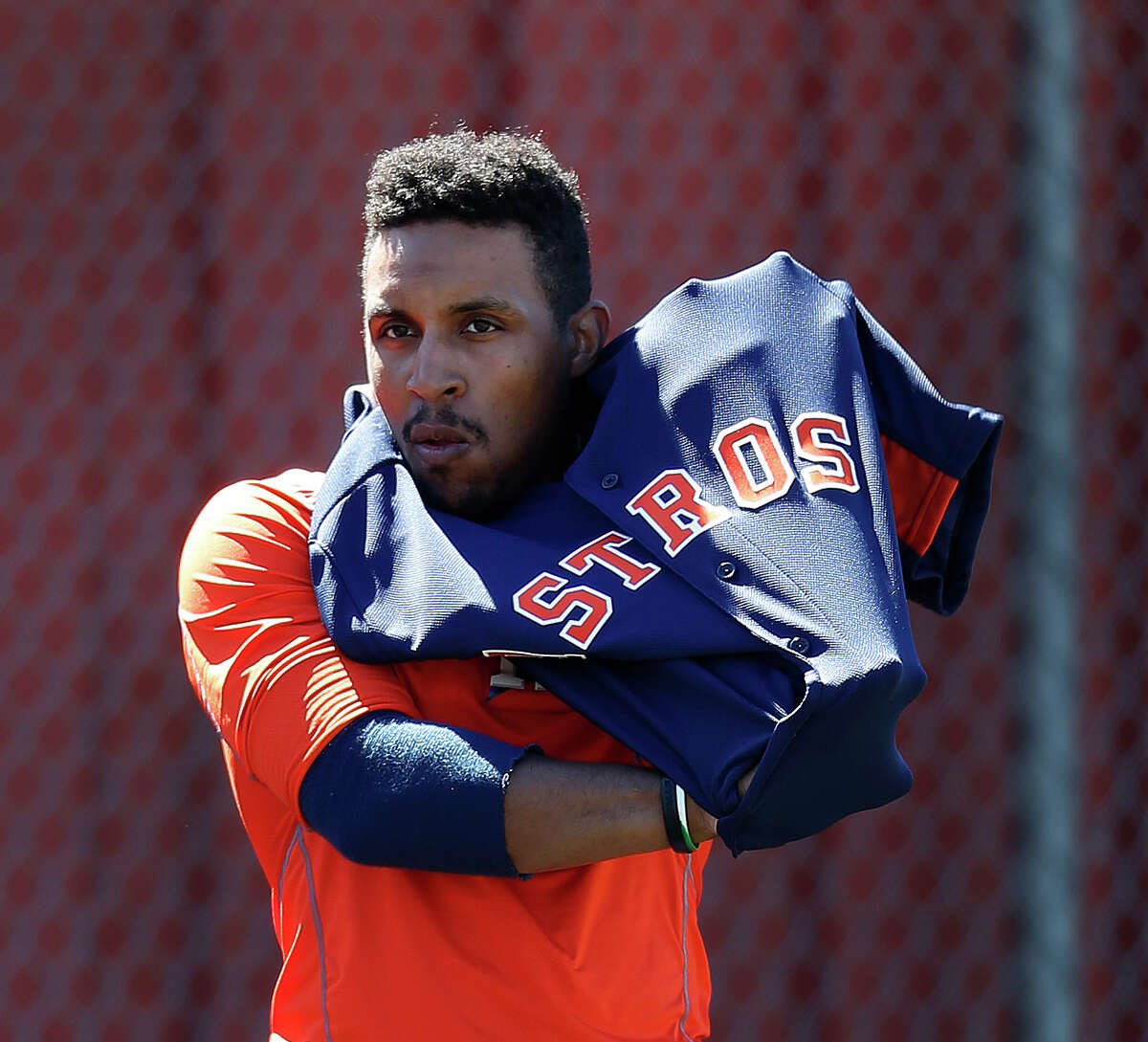 Houston Astros infielder Tony Kemp puts on his jersey at the Astros spring training in Kissimmee, Florida, Friday, Feb. 26, 2016.( Karen Warren / Houston Chronicle )