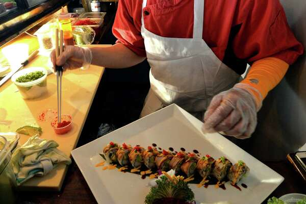 Chef and artist Phot Suphapha prepares the Bistro Roll dish at the Thai Thai bistro at 268 State Street Thursday afternoon May 22, 2014 in Schenectady, N.Y.    (Skip Dickstein / Times Union)