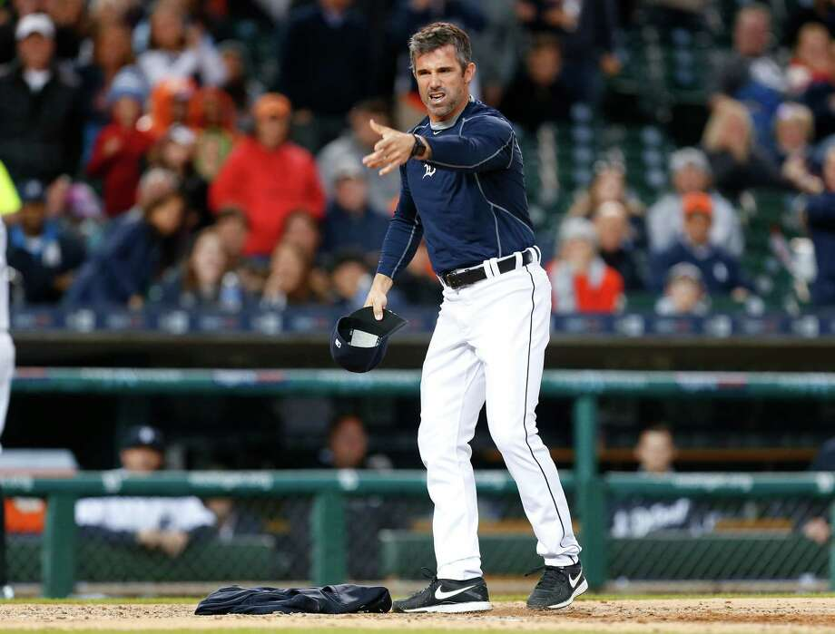 Detroit Tigers manager Brad Ausmus yells at home plate umpire Jeff Nelson after laying his sweatshirt on home plate against the Minnesota Twins in the fourth inning of a baseball game Monday, May 16, 2016 in Detroit. Ausmus was thrown out of the game. (AP Photo/Paul Sancya) Photo: Paul Sancya, Associated Press / Copyright 2016 The Associated Press. All rights reserved. This material may not be published, broadcast, rewritten or redistribu