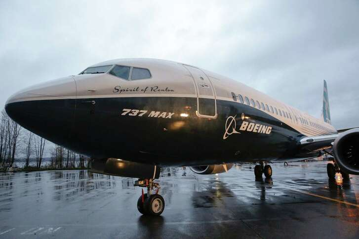 """(FILES) This file photo taken on December 8, 2015 shows Boeing's first 737 MAX named the """"Spirit of Renton"""" parked on the tarmac at the Boeing factory in Renton, Washington. Boeing reported lower first-quarter earnings and missed analyst expectations April 27, 2016 after announcing a charge of unanticipated costs of $156 million for building its KC-46 military aircraft. Earnings for the quarter ending March 31 were $1.2 billion, down 8.8 percent from the same period a year ago. That translated into $1.74 per share, nine cents below analyst expectations.  / AFP PHOTO / JASON REDMONDJASON REDMOND/AFP/Getty Images"""