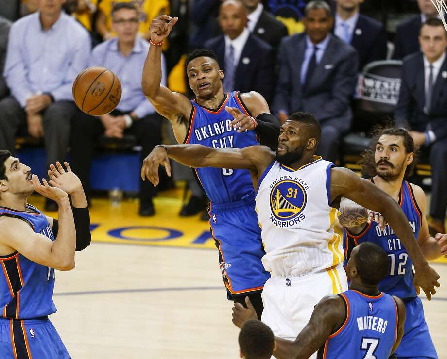 Oklahoma City Thunders� Russell Westbrook and Golden State Warriors� Festus Ezeli fight for a rebound in the third quarter during Game 1 of the NBA Western Conference Finals at Oracle Arena on Monday, May 16, 2016 in Oakland, Calif. Photo: Scott Strazzante, The Chronicle