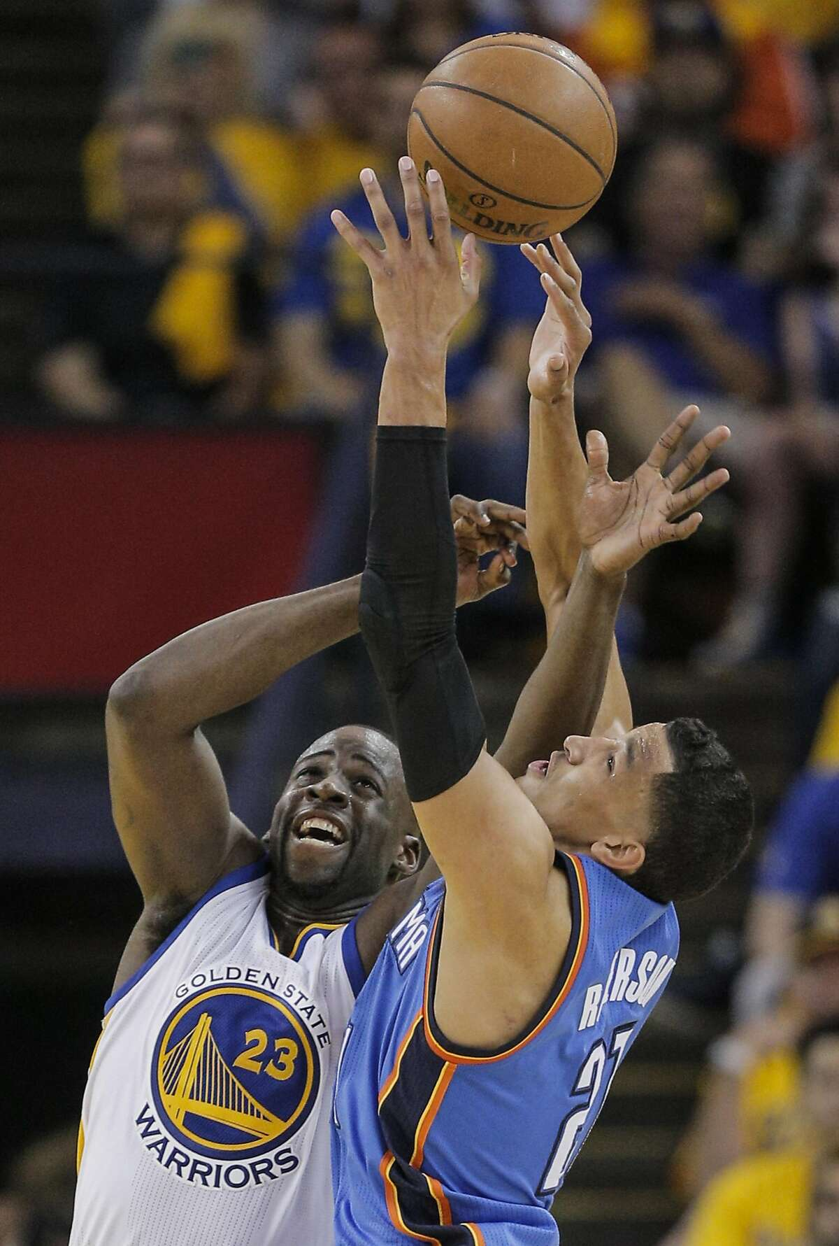 Golden State Warriors� Draymond Green and Oklahoma City Thunders� Andre Roberson fight for a fourth quarter rebound during Game 1 of the NBA Western Conference Finals at Oracle Arena on Monday, May 16, 2016 in Oakland, Calif.
