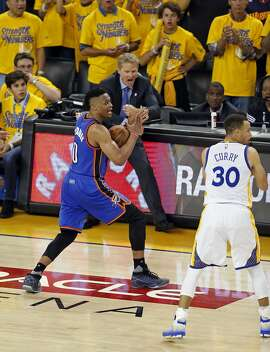 Oklahoma City Thunder's Russell Westbrook calls a timeout as Golden State Warriors' head coach Steve Kerr looks for a traveling call in the final minute of Thunder's 108-102 win in Game 1 of NBA Playoffs' Western Conference Finals at Oracle Arena in Oakland, Calif., on Monday, May 16, 2016.