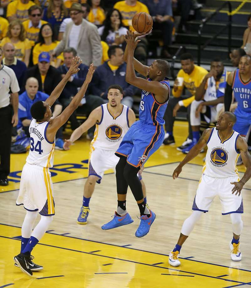 Oklahoma City Thunder's Kevin Durant scores between Golden State Warriors' Shaun Livingston, Klay Thompson and Andre Iguodala in 4th quarter during Game 1 of NBA Playoffs' Western Conference Finals at Oracle Arena in Oakland, Calif., on Monday, May 16, 2016. Photo: Scott Strazzante, The Chronicle