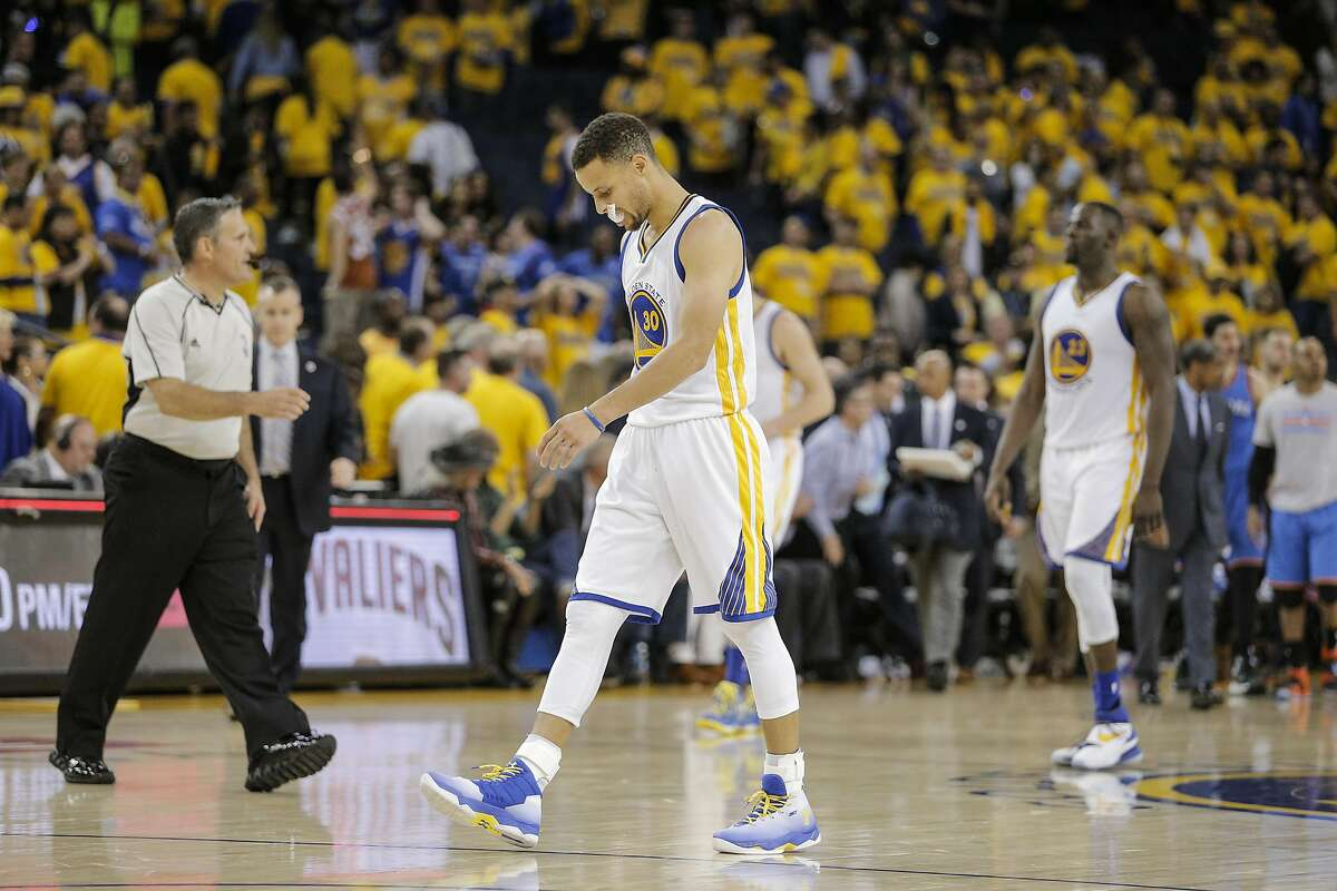 Golden State Warriors Stephen Curry walks off the court after the Warriors were defeated by the Oklahoma City Thunders 108 to 102 during Game 1 of the NBA Western Conference Finals at Oracle Arena on Monday, May 16, 2016 in Oakland, Calif.