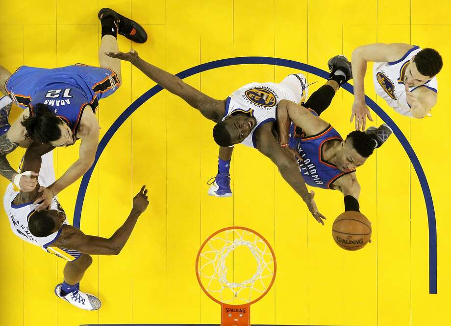 Russell Westbrook (0) drives in for a layup in the second half over Draymond Green (23) as the Golden State Warriors played Oklahoma City Thunder in Game 1 of the Western Conference Finals at Oracle Arena in Oakland, Calif., on Monday, May 16, 2016. Photo: Carlos Avila Gonzalez, The Chronicle