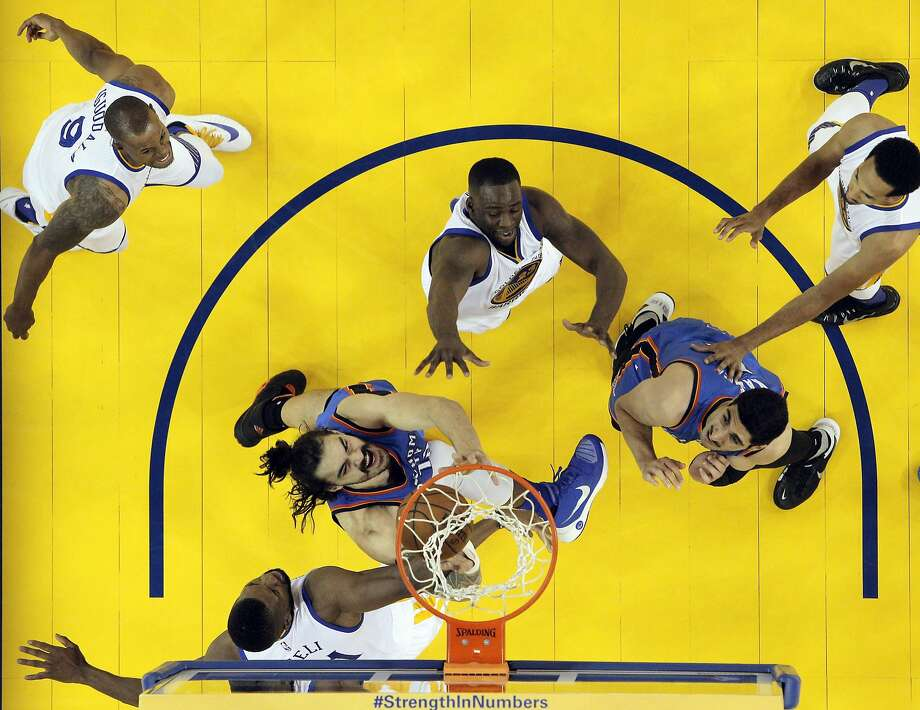 A scrum under the basket as a rebound comes off the rim in the first half as the Golden State Warriors played Oklahoma City Thunder in Game 1 of the Western Conference Finals at Oracle Arena in Oakland, Calif., on Monday, May 16, 2016. Photo: Carlos Avila Gonzalez, The Chronicle