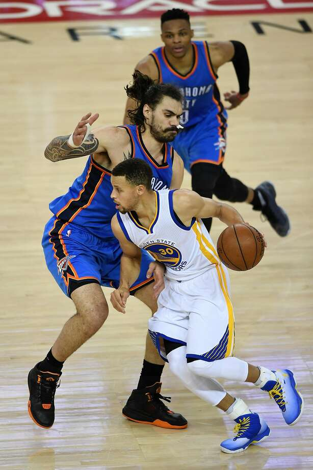 Stephen Curry drives around Thunder center Steven Adams in Monday's Game 1 at Oracle Arena. Photo: Thearon W. Henderson, Getty Images