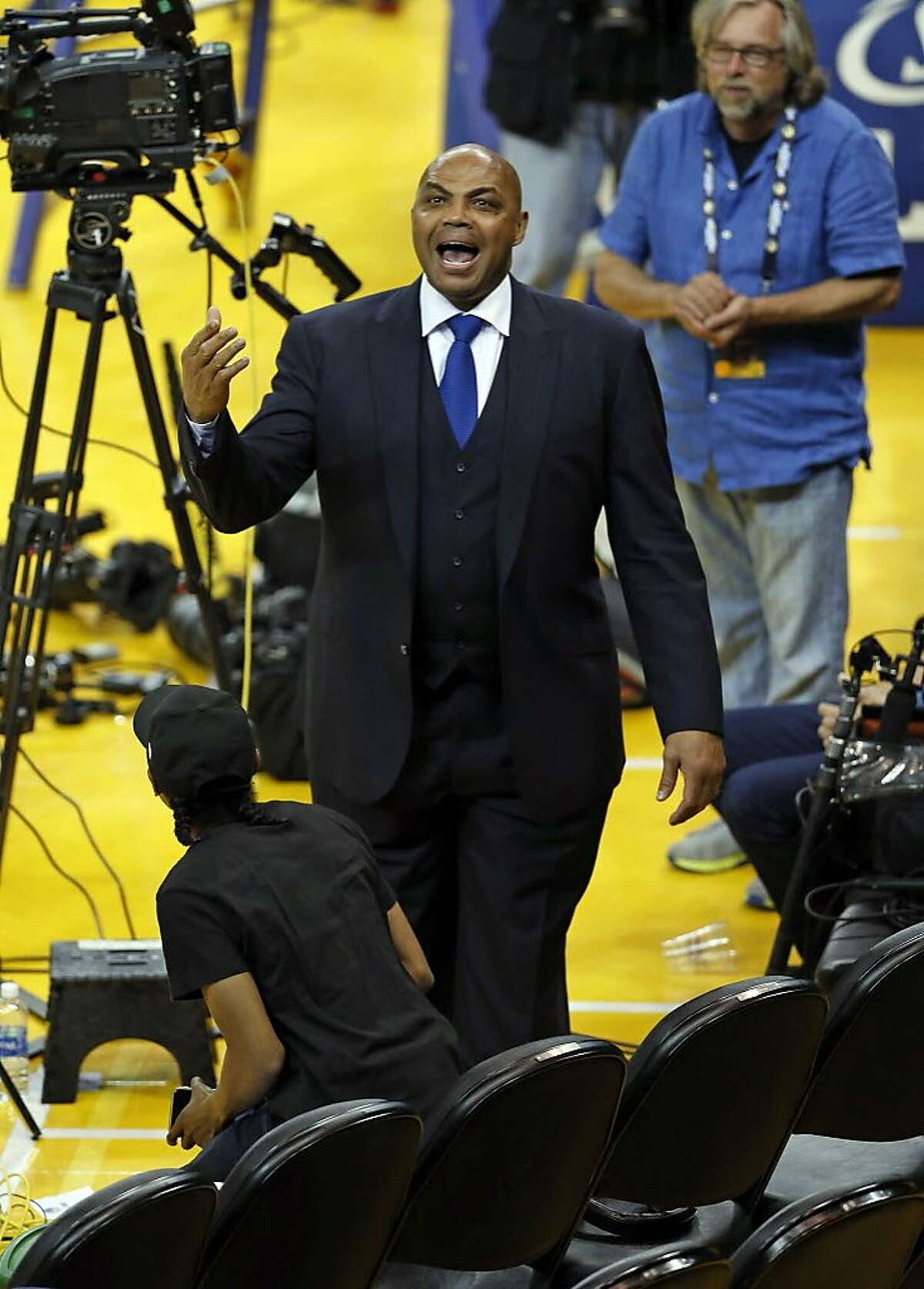 TNT commentator Charles Barkley has a heated conversation with a heckler after Golden State Warriors' 108-102 loss to Oklahoma City Thunder in Game 1 of NBA Playoffs' Western Conference Finals at Oracle Arena in Oakland, Calif., on Monday, May 16, 2016.