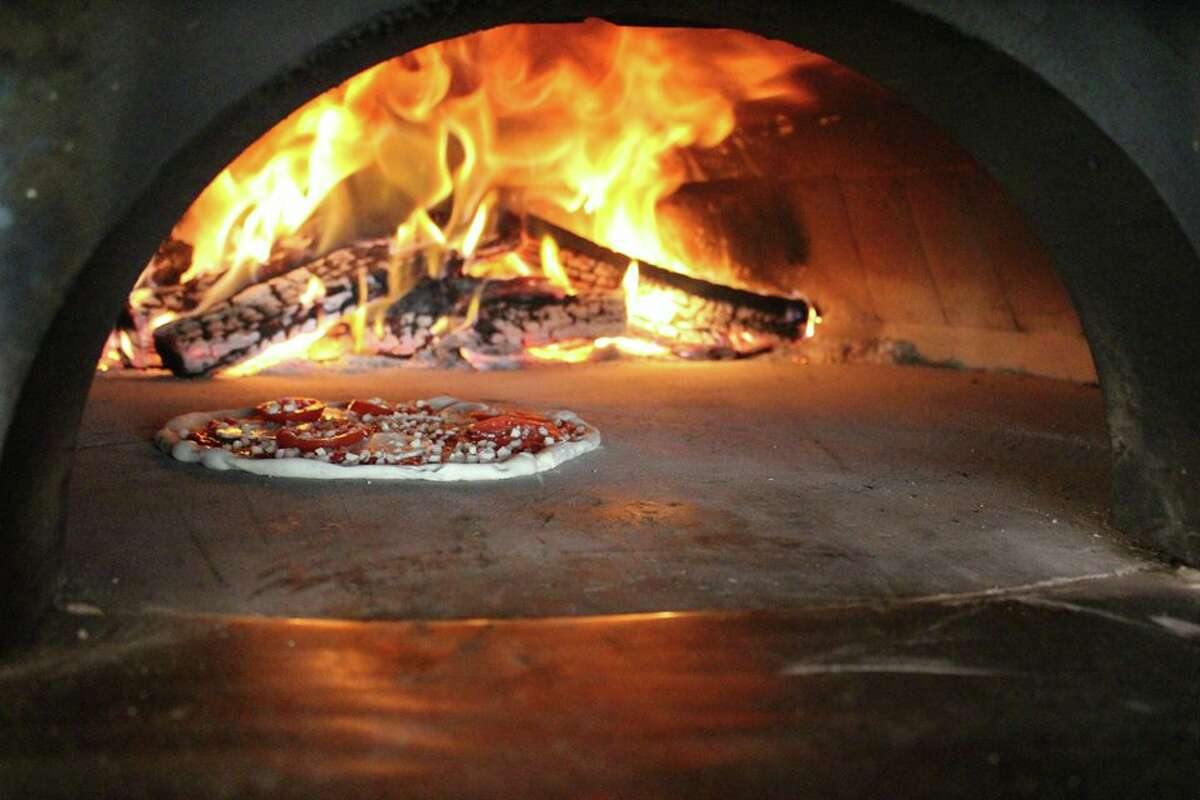 Bollo Woodfired Pizza, 2202 W. Alabama, is marking its one-year anniversary with food and drink specials on May 25, 2016.