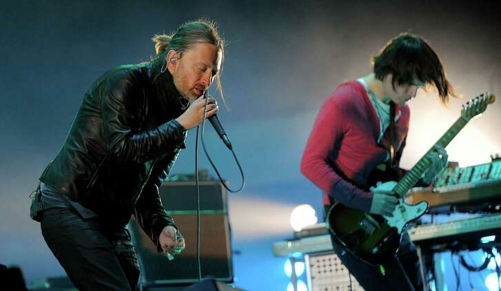 Thom Yorke, left, and Jonny Greenwood of Radiohead perform in 2012 at Coachella in Indio, Calif. The band's latest album combines the personal with broader comments on society.