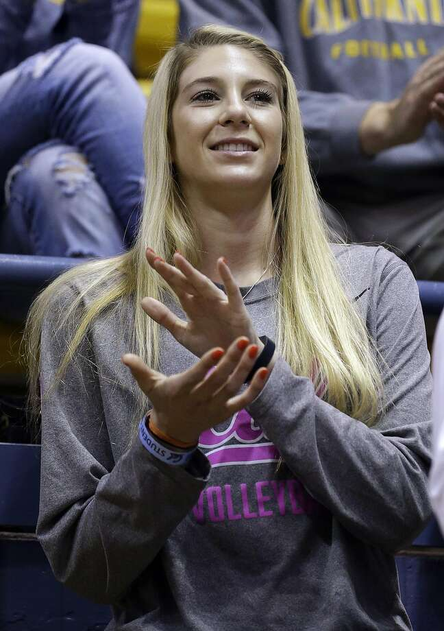 In this Sunday, Feb. 28, 2016, photo, California volleyball player Savannah Rennie cheers the men's basketball team in the first half of an NCAA college basketball game against Southern Calfiornia in Berkeley, Calif. Rennie is headed to Indiana University this Sunday to await a liver transplant for a rare disease that has kept her off the court,  and determined to play volleyball again surrounded by a campus community that is supporting her every step of the way. (AP Photo/Ben Margot) Photo: Ben Margot, AP