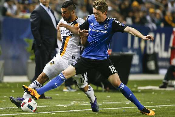 San Jose Earthquake's Kip Colvey battles Los Angeles Galaxy's Sebastian Lletget for control along the corner sideline during the first half of a MLS soccer game Saturday, March 19, 2016, in Carson, Calif. (AP Photo/Lenny Ignelzi)