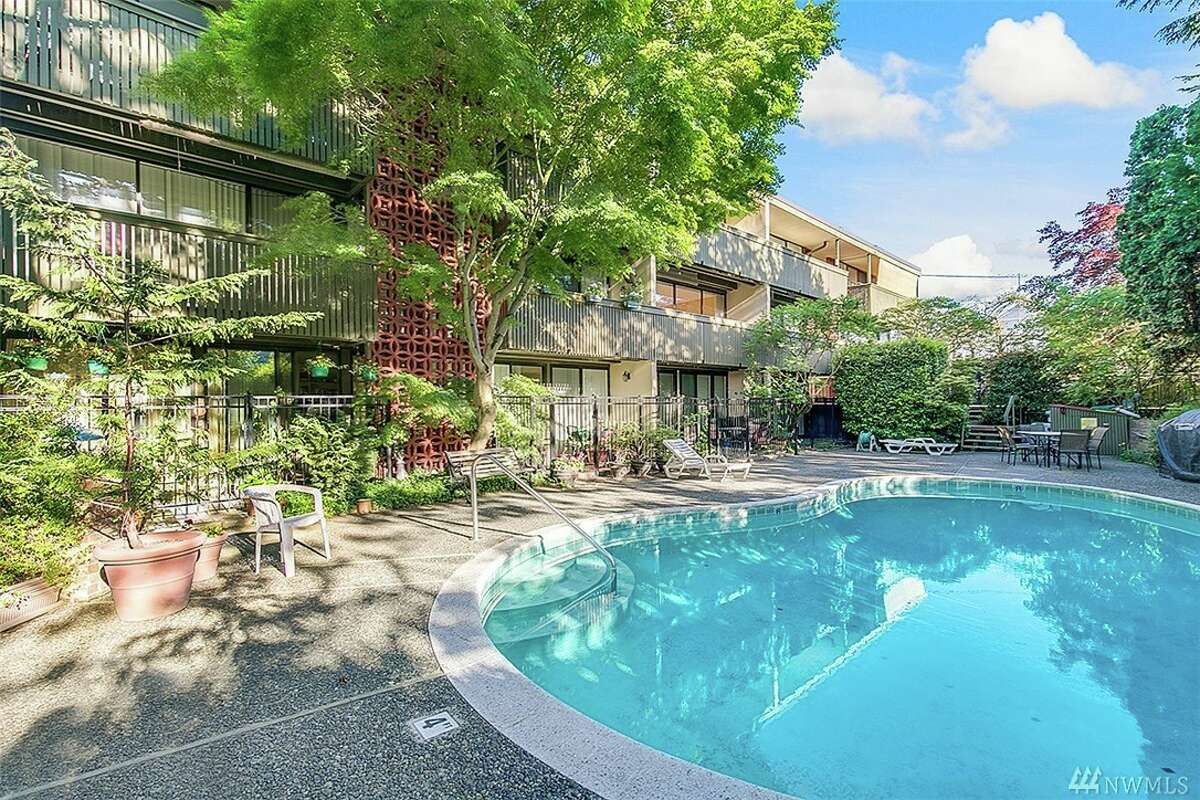 The first condo, at 1616 41st Ave. E. #203, is listed for $380,000. The one-bedroom, one-bathroom condo is 680 square feet. The unit is in a building with professionally landscaped grounds, a community pool and a dedicated parking space. You can see the full listing here.