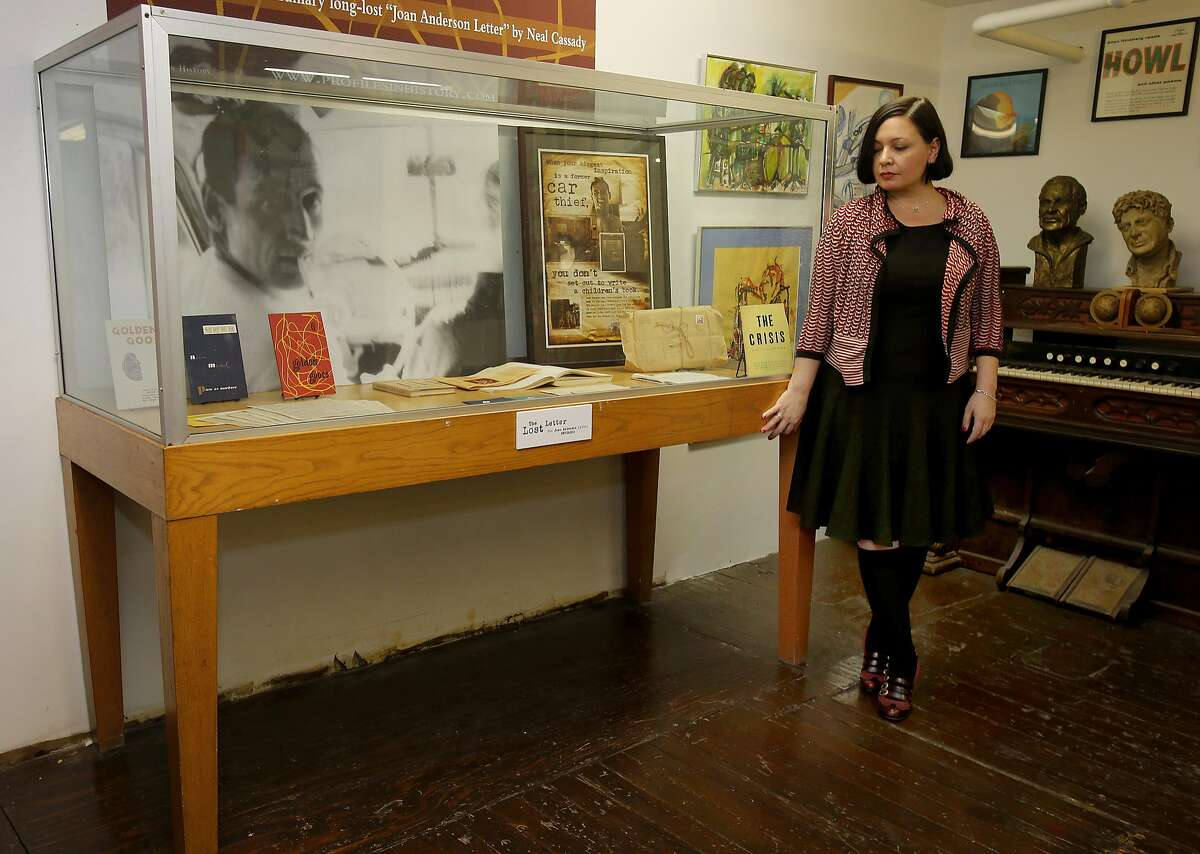 """Jean Spinosa, who owns the letter, stands by a display case containing the letter and other Neal Cassady memorabilia Monday December 1, 2014. A lost letter written from BEAT hero Neal Cassady to author Jack Kerouac was displayed at the Beat Museum in San Francisco, Calif. before being auctioned soon. The letter is purportedly what caused Kerouac to start over with """"On the Road,"""" his famous novel of the Beats."""