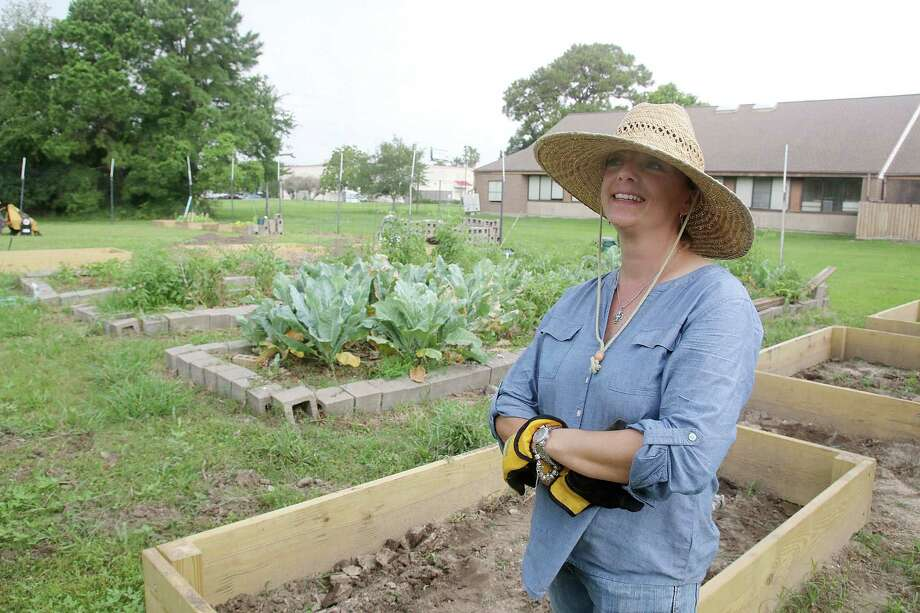 """Ally Hardick, garden ministry leader of Providence Garden at St. Christopher Episcopal Church in League City, wants to expand the purpose of the garden beyond providing food for a local service ministry. Goals including teaching children how to grow food and offering cooking and nutrition classes. """"My goal is to flip things around, make a difference and make gardening cool again,"""" she says. Photo: Pin Lim, Freelance / Copyright Forest Photography, 2015."""