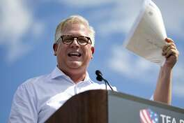 "FILE - In this Wednesday Sept. 9, 2015, file photo, radio host Glenn Beck speaks during a Tea Party rally against the Iran deal on the West Lawn of the Capitol in Washington. Beck and American Enterprise Institute president Arthur Brooks are some of the conservative leaders Facebook CEO Mark Zuckerberg plans to meet with on Wednesday, May 18, 2016, in light of a report that Facebook downplays conservative news subjects in its ""Trending Topics"" feature. Facebook has denied the claims, but Zuckerberg said the company is investigating it nonetheless. (AP Photo/Jacquelyn Martin, File)"