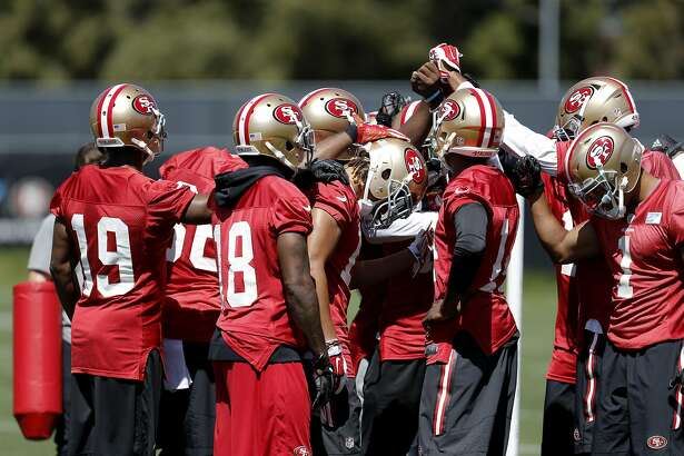 A group of receivers huddle up during drills at a San Francisco 49ers mini camp workout at their practice facility in Santa Clara, California, on Tues. May 17, 2016.