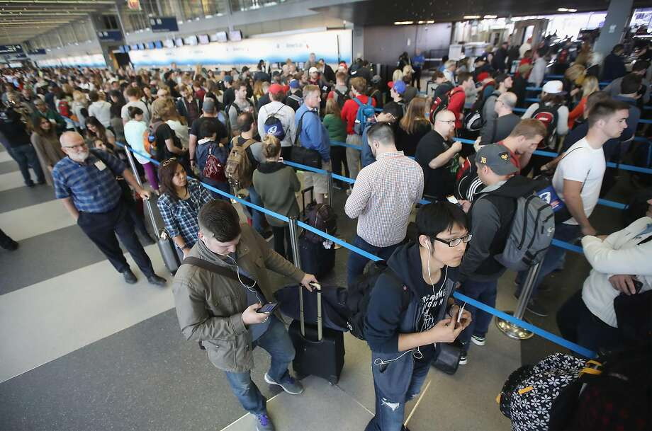 Passengers at O'Hare International Airport wait to be screened Monday. Photo: Scott Olson, Getty Images
