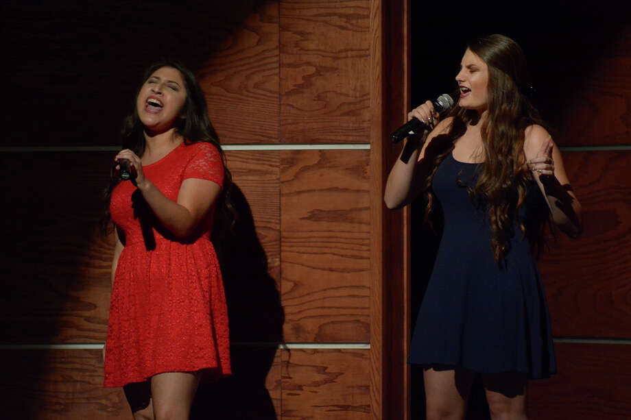 Jasmine Andrade, left, and Alisa Pock performed during the Spring High Pop Show. The school received the Grammy Signature Schools Enterprise Award, which is given to schools that maintain high standards under financial challenges. Photo: Jerry Baker, Freelance