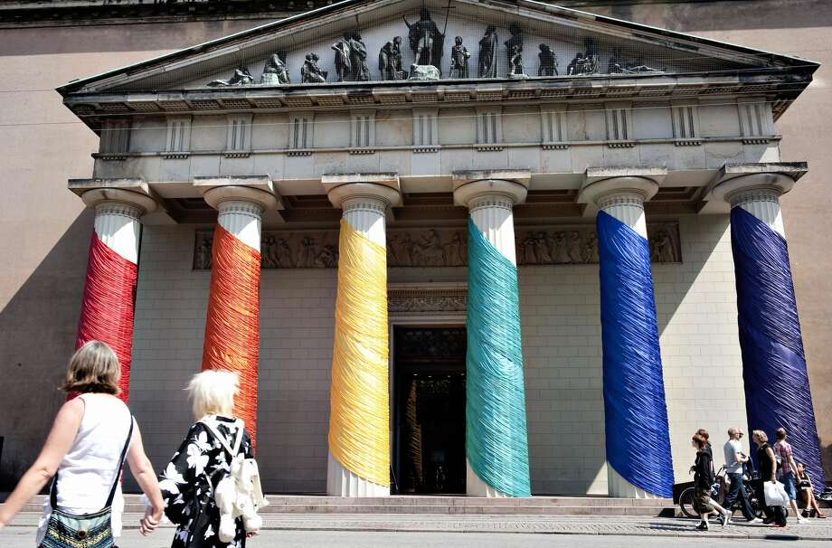A lesbian couple walks past the Copenhagen Cathedral on July 29. 2009 with its pilars covered with the colors of the 2009 World Outgames. The sports and cultural event, comprising 5,500 participants from 98 countries, is held in Copenhagen for eight days, from July 25 to August 2, to promote homosexual rights worldwide and are organized by The Lesbian, Gay, Bisexual and Transgender (LGBT) community. AFP PHOTO / Casper Christoffersen (Photo credit should read Casper Christoffersen/AFP/Getty Images)