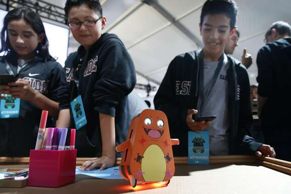 East Palo Alto middle school students Juan Garcia, Ernesto Cambron and Xavier Herrera bring robotic monsters to life at the Google I/O Youth conference in Mountain View, Calif. on Tuesday, May 17, 2016.
