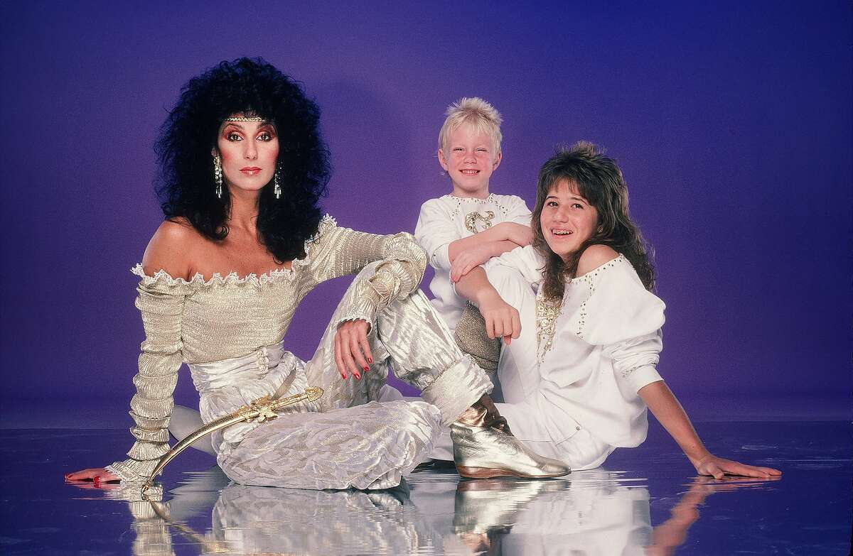 Cher poses with her children Chaz Bono, right, and Elijah Blue Allman, in June 1981 in Los Angeles.