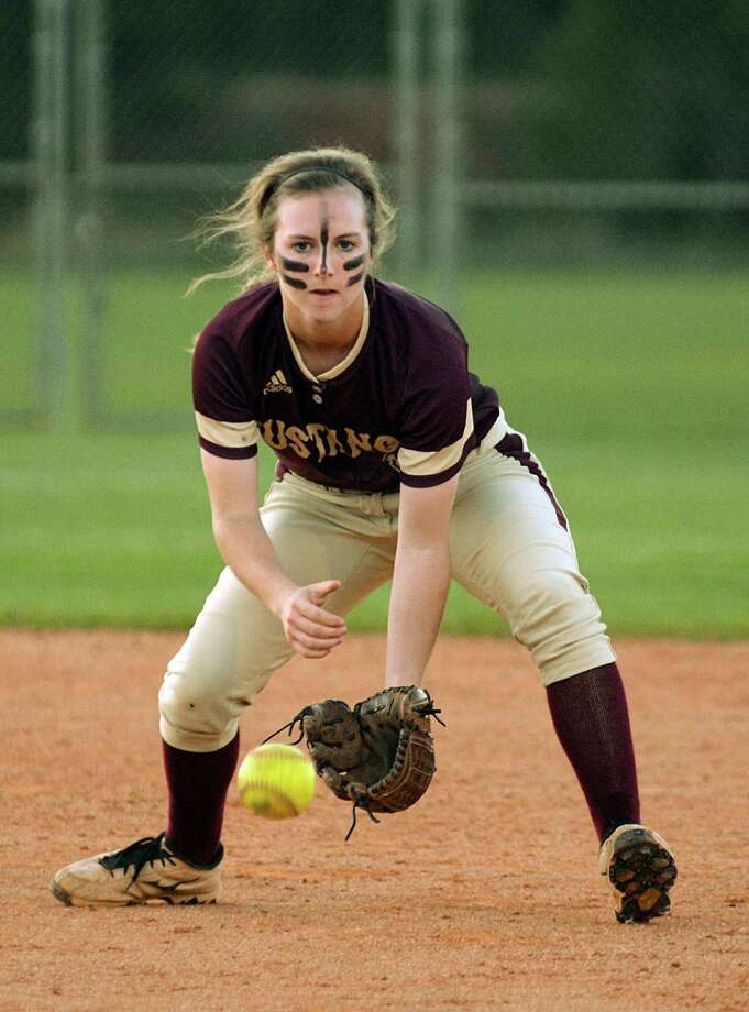 Magnolia West shorststop Emma McBride charges a grounder during the Magnolia West at Magnolia softball game.  Photograph by David Hopper Photo: Z-David Hopper