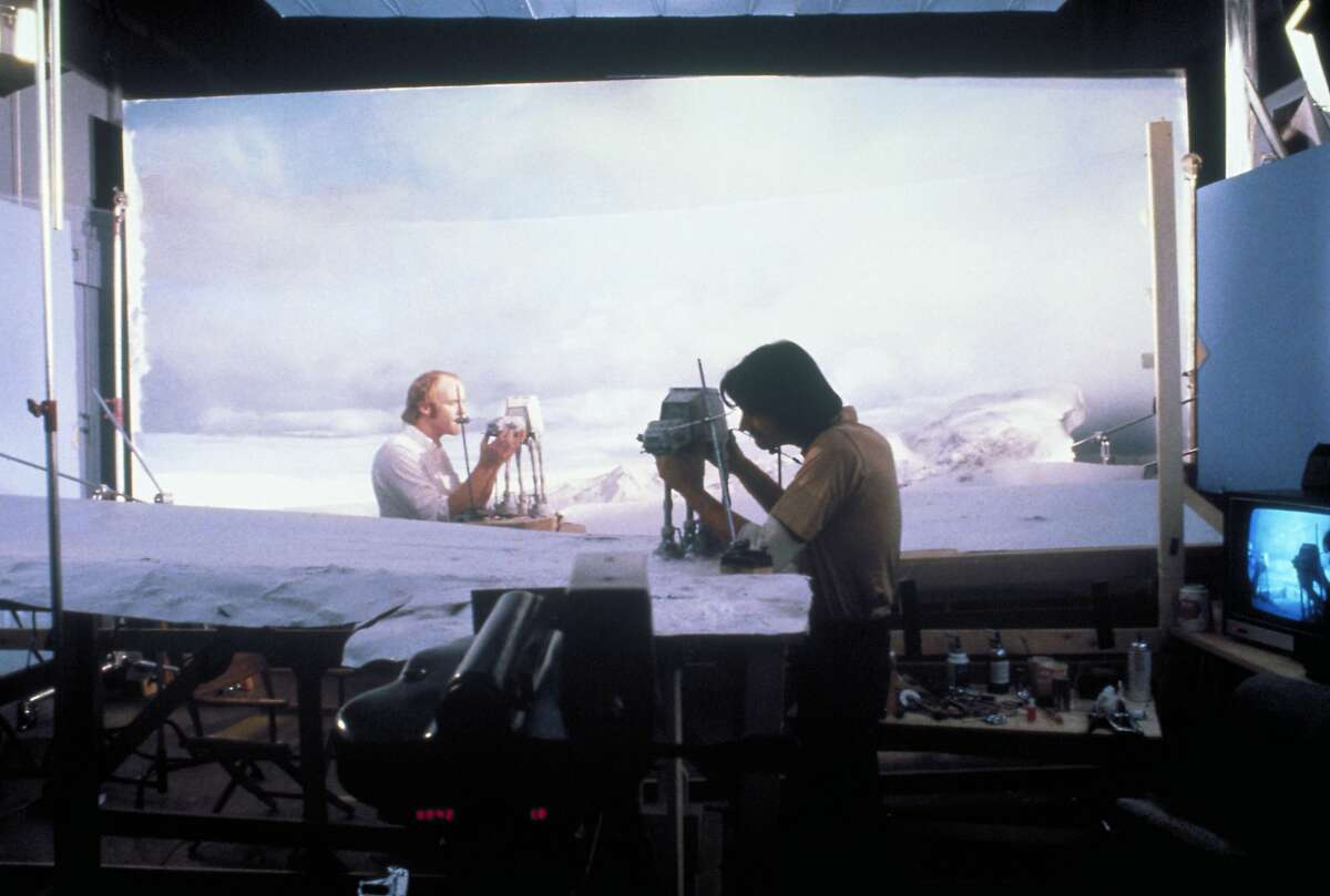"""Phil Tippett, left, and Jon Berg work on the snow walker puppets for the planet Hoth battle scene in """"The Empire Strikes Back."""""""