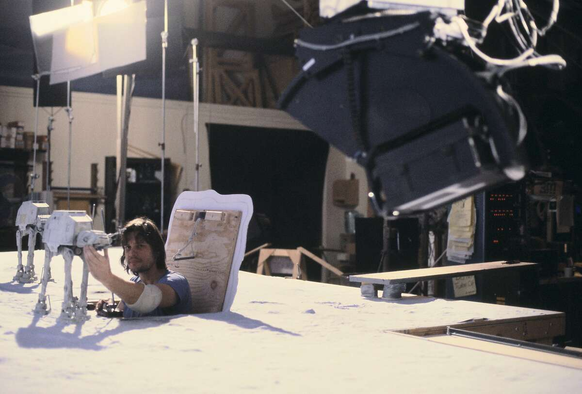 """Jon Berg pops out of a hatch to work on one of the snow walker puppets for the ice planet Hoth battle scene in the 1980 movie """"The Empire Strikes Back."""""""