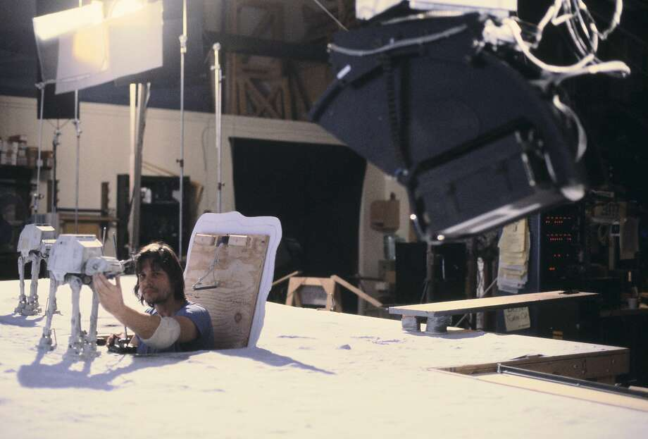 "Jon Berg pops out of a hatch to work on one of the snow walker puppets for the ice planet Hoth battle scene in the 1980 movie ""The Empire Strikes Back."" Photo: Courtesy Lucasfilm"