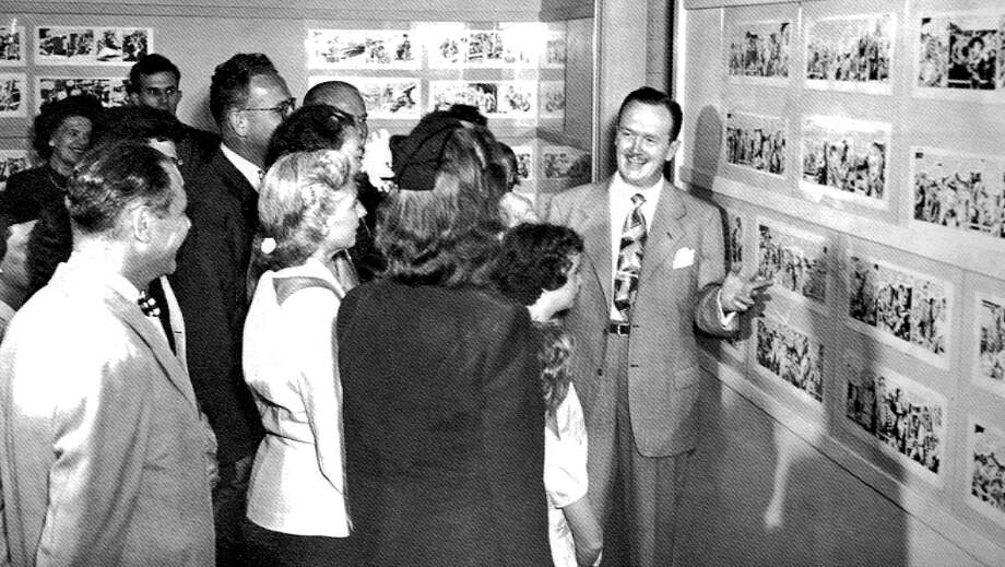 "Alex Raymond, right, hosted a one-man exhibit of his original art at Stamford Museum in August 1948. Raymond, a longtime Stamford, Connecticut, resident, was best known for his work on the ""Flash Gordon"" and ""Rip Kirby"" comics. A few months later, the museum held an exhibit of several comics creators who lived in the area. Photo: File Photo / Stamford Advocate  contributed"