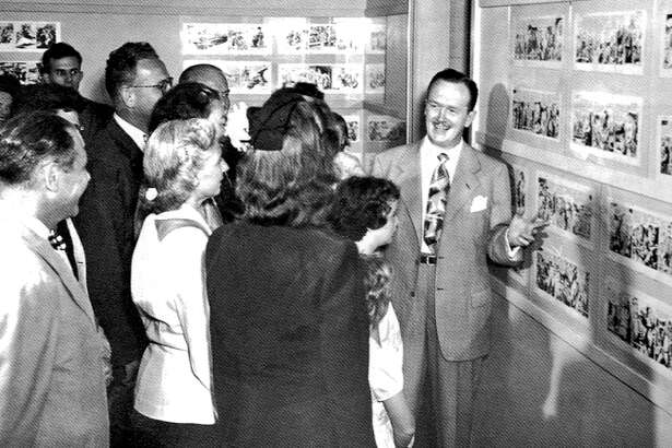 "Alex Raymond, right, hosted a one-man exhibit of his original art at Stamford Museum in August 1948. Raymond, a longtime Stamford, Connecticut, resident, was best known for his work on the ""Flash Gordon"" and ""Rip Kirby"" comics. A few months later, the museum held an exhibit of several comics creators who lived in the area."