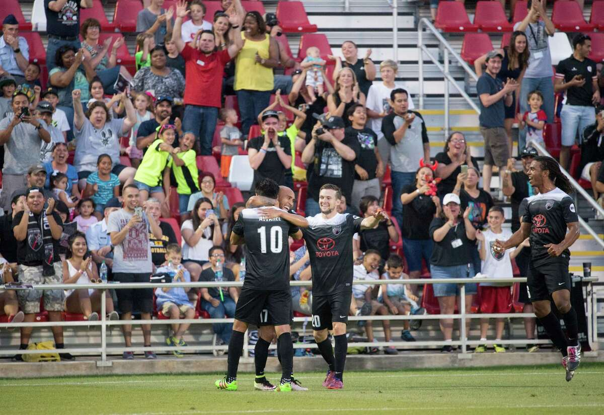 San Antonio FC players celebrate a goal by forward Shawn Chin during the first half of a USL soccer match against the Tulsa Roughnecks FC on April 30, 2016, at Toyota Field in San Antonio.