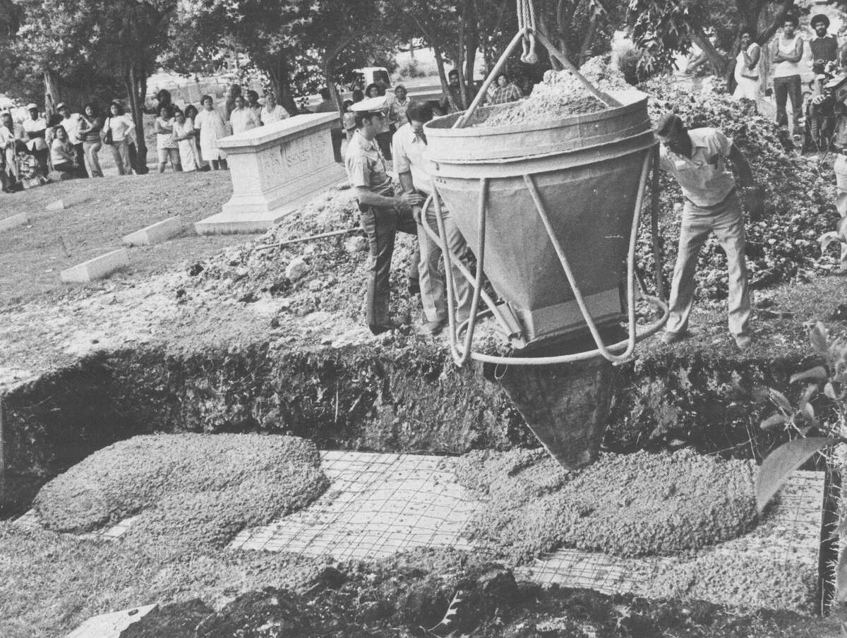 In this May 1977 file photo, concrete is dumped on top of the crate in Sandra West's grave containing her Ferrari with West in the driver's seat, as she requested. Express-News file photo by Joe Barrera Jr.