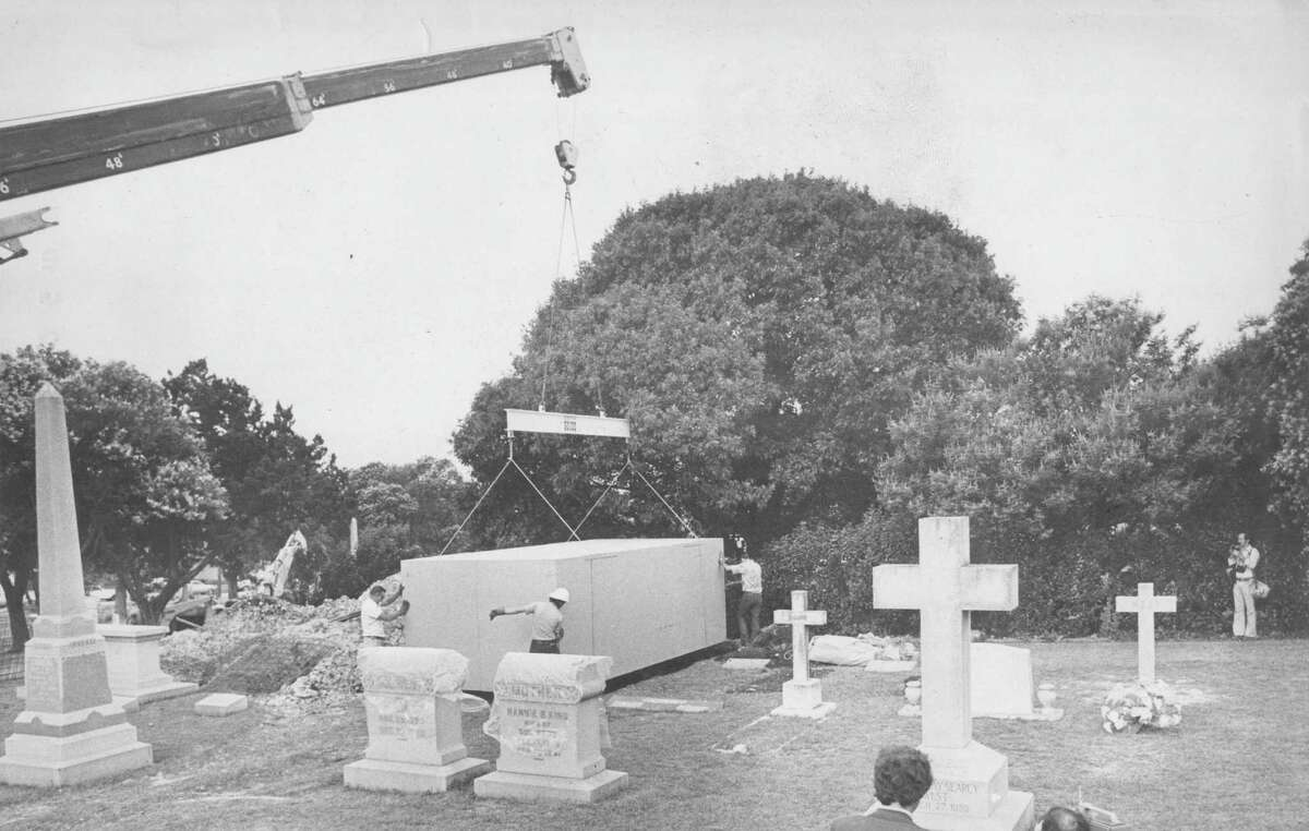 This May 18, 1977 file photo shows a crate containing a Ferrari automobile, with Sandra Ilene West seated at its steering wheel, being lowered into her grave. The wealthy woman requested to be dressed in her favorite nightgown and seated inside the vehicle before burial. Funeral home officials enclosed the car in the crate, then poured tons of concrete on top of it to prevent vandals from robbing the grave. Express-News file photo by Tarky Tarsikes