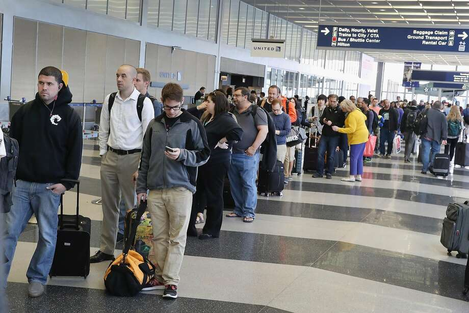 Passengers at O'Hare International Airport wait in line to be screened at a Transportation Security Administration (TSA) checkpoint on May 16, 2016 in Chicago, Illinois. Waiting times at the checkpoints have been reported to be as long 2 hours. Photo: Scott Olson, Getty Images