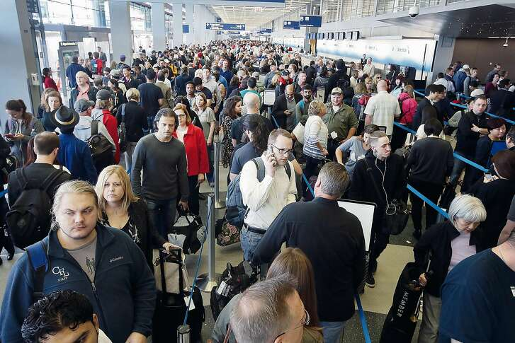 CHICAGO, IL - MAY 16:  Passengers at O'Hare International Airport wait in line to be screened at a Transportation Security Administration (TSA) checkpoint on May 16, 2016 in Chicago, Illinois. Waiting times at the checkpoints today have been reported to be as long 2 hours. The long lines have been blamed for flight delays and a large number of passengers missing flights completely.  (Photo by Scott Olson/Getty Images) *** BESTPIX ***