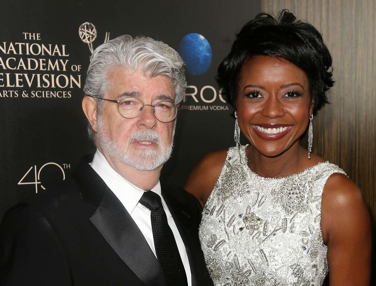 FILE - This June 16, 2013 file photo released by Entertainment Fusion Group shows producer George Lucas, left, and his wife Mellody Hobson at The 40th Annual Daytime Emmy Awards in Beverly Hills. Lucas and his wife Mellody Hobson have had a baby daughter, born via surrogate. Representatives for the 69-year-old filmmaker announced the birth Monday, Aug. 12. Everest Hobson Lucas was born Friday, the first child for Lucas and Hobson, who were married in June. (AP Photo/Entertainment Fusion Group, Ryan Miller)